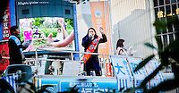 Happiness Realization Party candidate sings to the crowd in Shibuya.