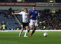 Gavin Reilly pressures Lee Wallace in the Rangers v Queen of the South Quarter Final match in the Ramsdens Cup played at Ibrox Stadium, Glasgow on 18.9.12.