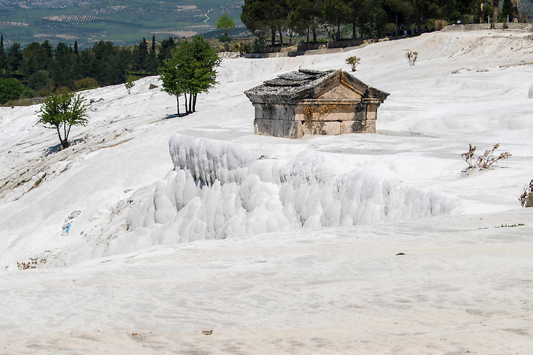 An ancient mausoleum in Hierapolis is slowly being overtaken by calcified terraces.