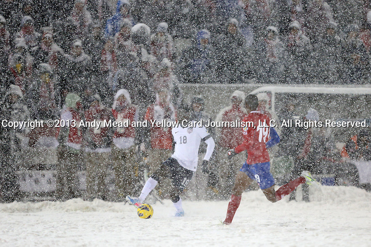 22 March 2013: Eddie Johnson (USA) (18) is defended by Roy Miller (CRC) (19) in driving snow. The United States Men's National Team played the Costa Rica Men's National Team at Dick's Sporting Goods Park in Commerce City, Colorado in a CONCACAF World Cup Qualifying Final Round match for the 2014 FIFA World Cup. The United States won the game 1-0.