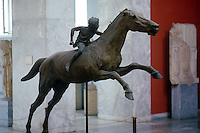 """The """"""""jockey"""""""" of Artemision. The statue represents a youth riding a horse. He probably held the reins in his left hand and a whip in the right. It was found in pieces, in the area of a shipwreck off the cape Artemision, in north Euboea. Dated to c.140 B.C."""