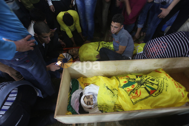 Mourners carry the body of Palestinian Matar Abu Ata, 20, killed in a recent Israeli strike, during his funeral in Gaza City, Sunday, Nov. 11, 2012. While cross-border fighting is a common occurrence, hostilities spiraled sharply over the weekend, with bombardments from Gaza causing rare Israeli casualties and Israeli strikes killing at least six Palestinians. Photo by Ashraf Amra