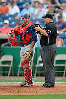 Boston Red Sox catcher Daniel Butler #61 and umpire Eric Cooper during a Spring Training game against the Philadelphia Phillies at Bright House Field on March 24, 2013 in Clearwater, Florida.  Boston defeated Philadelphia 7-6.  (Mike Janes/Four Seam Images)