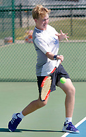 NWA Democrat-Gazette/DAVID GOTTSCHALK  Har-Ber High School's Conor Clardy competes Friday, October 6, 2017, in the 7A-West Conference tennis tournament at Springdale Har-Ber High School tennis courts in Springdale. Clardy was playing against Fayetteville High School's Jake Sweeney.