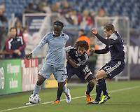 Sporting Kansas City midfielder Kei Kamara (23) attempts to control the ball as New England Revolution defender Kevin Alston (30) and New England Revolution forward Zak Boggs (33) pressure. In a Major League Soccer (MLS) match, the New England Revolution defeated Sporting Kansas City, 3-2, at Gillette Stadium on April 23, 2011.