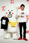 """(L to R) Motchy The Kakkoi-inu character and the actor Tomonori Jinnai pose for the cameras during a special Uniqlo media event to promote the """"UTme!"""" smart phone application on April 28, 2015. The application allows customers to upload their own designs to sell through """"UTme! Market"""". Customers also can select new effects, characters and designs from Coca-Cola, Mottchy the Kakkoii-inu and fashion magazine Non-no. (Photo by Rodrigo Reyes Marin/AFLO)"""