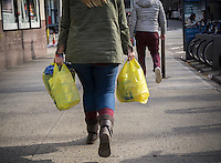 A shopper with her supermarket plastic bags in New York on Friday, December 23, 2016. After a delay earlier this year the New York City plastic bag bill, requiring a 5 cent fee on disposable plastic bags, is set to take effect in February 2017. (© Richard B. Levine)
