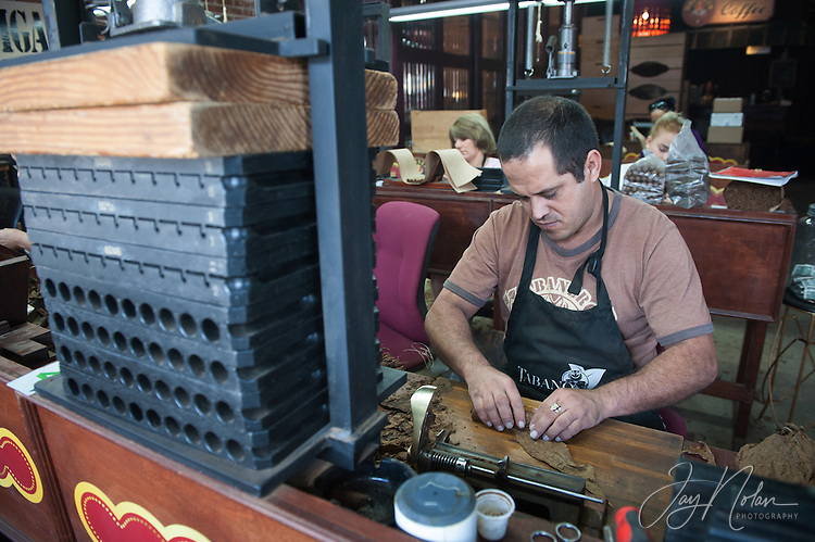 A cigar maker, &lsquo;Leyva&rsquo;, rolls cigars in a shop along 7th Avenue in Ybor City today, Thursday 6/11/15.<br />