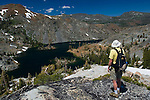 Hiker overlooking Heather Lake in the high alpine mountains of Desolation Wilderness, El Dorado National Forest, California