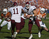 24 November 2006: Texas A&M quarterback Stephen McGee (#7) prepares to handoff to Jovorskie Lane (#11) during the Aggies 12-7 victory over the University of Texas Longhorns at Darrell K Royal Memorial Field in Austin, TX.