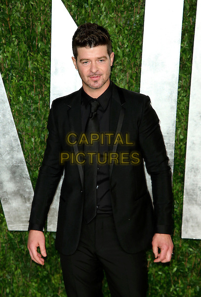 Robin Thicke.2013 Vanity Fair Oscar Party following the 85th Academy Awards held at the Sunset Tower Hotel, West Hollywood, California, USA..February 24th, 2013.oscars half length black suit stubble facial hair  .CAP/ADM/SLP/DOW.©Dowling/StarlitePics/AdMedia/Capital Pictures