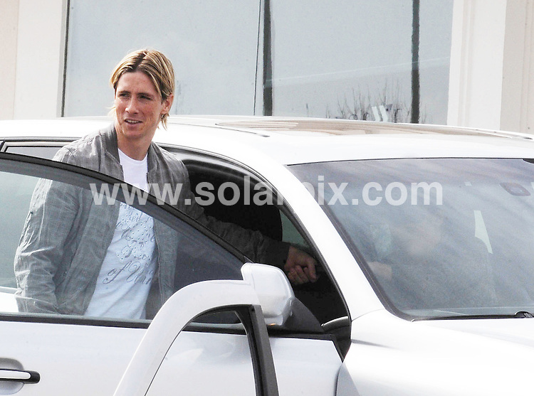 **ALL ROUND EXCLUSIVE PICTURES FROM SOLARPIX.COM**.**WORLDWIDE SYNDICATION RIGHTS EXCLUDING SPAIN - NO PUBLICATION IN SPAIN**.Liverpool striker Fernando Torres was spotted leaving a Madrid bakery carrying his own birthday cakes with the numbers 26 taped to the side. The Spanish goal  machine had to wait until three days after his birthday to celebrate with friends and family in Madrid, due to the match on Sunday which saw Liverpool go on to lose 2-1 to Manchester Utd after Torres headed in the first goal of the match to put Liverpool in the lead..Torres' 26th birthday was on Saturday 20th March and although it was late, he was wished a very happy birthday by the shop keeper and fans waiting outside..JOB REF:   10968     RAM       DATE:   24.03.10.**MUST CREDIT SOLARPIX.COM OR DOUBLE FEE WILL BE CHARGED**.**MUST AGREE FEE BEFORE ONLINE USAGE**.**CALL US ON: +34 952 811 768 or LOW RATE FROM UK 0844 617 7637**