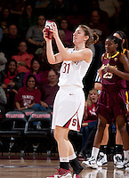 STANFORD, CA - January 8, 2011: Toni Kokenis of the Stanford Cardinal women's basketball team collects her shoe during Stanford's game against Arizona State at Maples Pavilion. Stanford won 82-35.