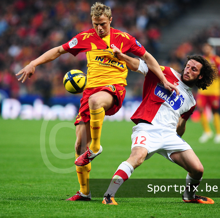 20110416 - LENS , FRANCE : RC Lens'  DAVID POLLET (left) pictured with Brest's Paul Baysse (r) during the soccer match between Racing Club de LENS and BREST , on the thirty first  matchday in the French Ligue 1 at the Stade Bollaert Delelis stadium , Lens . Saturday 16 April 2011 . PHOTO DAVID CATRY