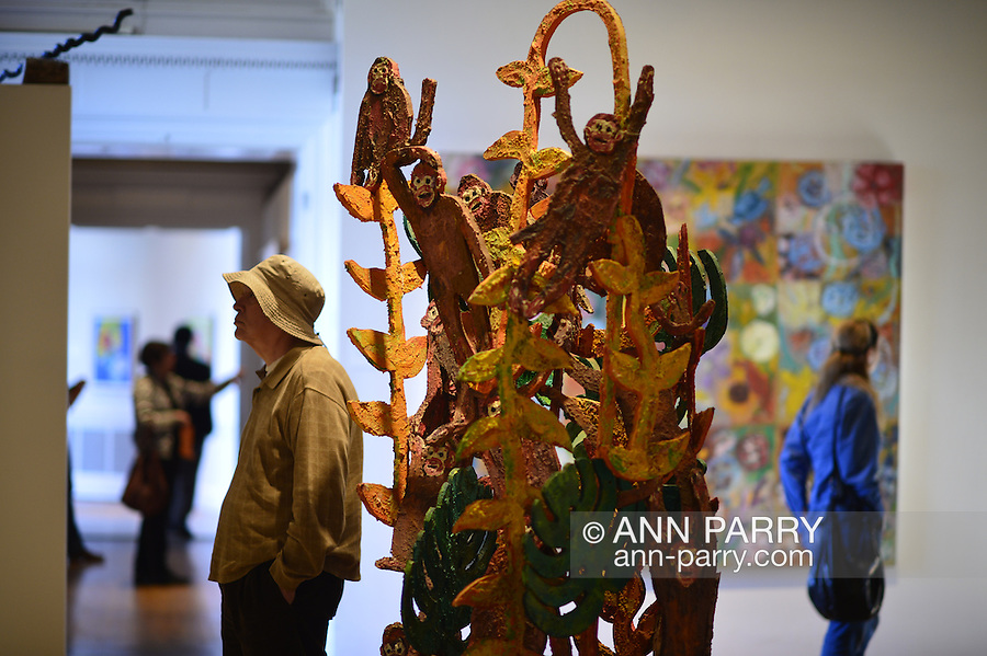 Roslyn, New York, U.S. - April 12, 2014 - During International Slow Art Day, an annual worldwide event celebrating art, visitors view the outdoor sculptures and the Garden Party and the AftermodernisM exhibits at the Nassau County Museum of Art on Long Island. Hunt Slonem's colorful sculptures of wildlife, birds and tropical plants