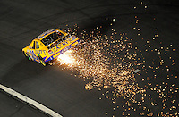 Oct. 15, 2009; Concord, NC, USA; NASCAR Nationwide Series driver John Wes Townley sparks from bottoming out during the Dollar General 300 at Lowes Motor Speedway. Mandatory Credit: Mark J. Rebilas-
