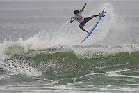 Brazilian Miguel Pupo with a huge air during round of 48 at the 2010 US Open of Surfing in Huntington Beach, California on August 5, 2010.