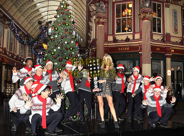 Denise Van Outen .rewinds a live performance of her favourite Christmas carols sung by Britain's Got Talent a capella sensations - 'Out of the Blue' at Leadenhall Market, London, England..26th November 2012.full length gold sparkly dress black ankle boots giant oversized remote control santa claud hat red sweater jumper top jeans denim posing scarf silver wrap.CAP/PP/MT.©Mickey Townsend/PP/Capital Pictures
