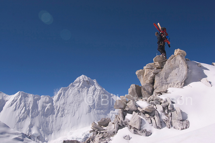 A photo of a man climbing with skis on Mount Cho Oyu  in the himalay mountains of Tibet.