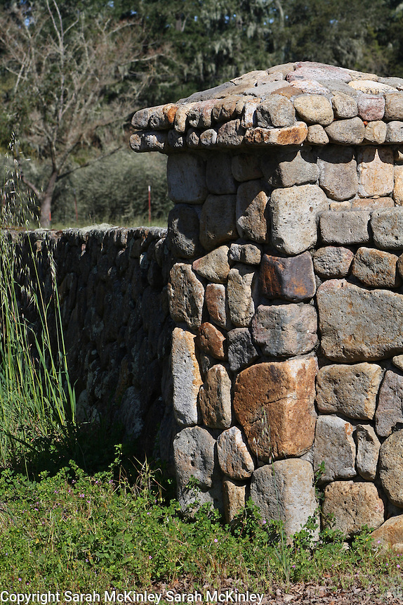 The gatepost of a stone fence on Highway 128 between Geyserville and Calistoga in Napa County in Northern California.