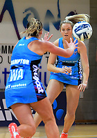 Jamie Hume (right) passes to Gina Crampton during the ANZ Premiership netball match between the Central Pulse and Northern Stars at Te Rauparaha Arena in Wellington, New Zealand on Wednesday, 24 May 2017. Photo: Dave Lintott / lintottphoto.co.nz