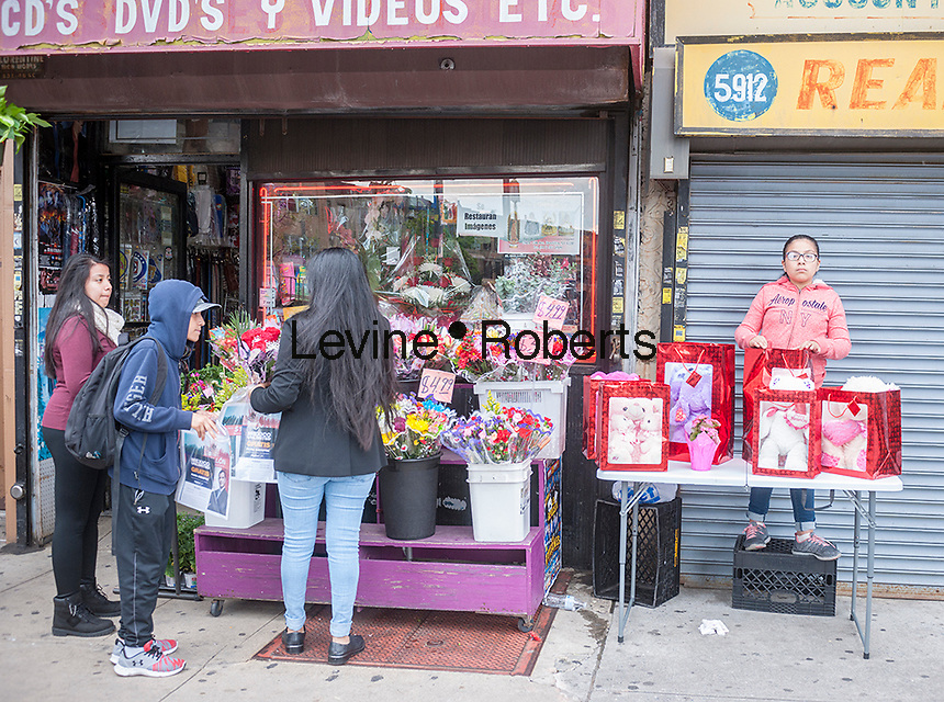 Mexican flower seller in the neighborhood of Sunset Park in Brooklyn in New York, seen on Sunday, May 14, 2017. The area is home to a polyglot of immigrants including Mexican, Middle-Eastern and Asian. (© Richard B. Levine)