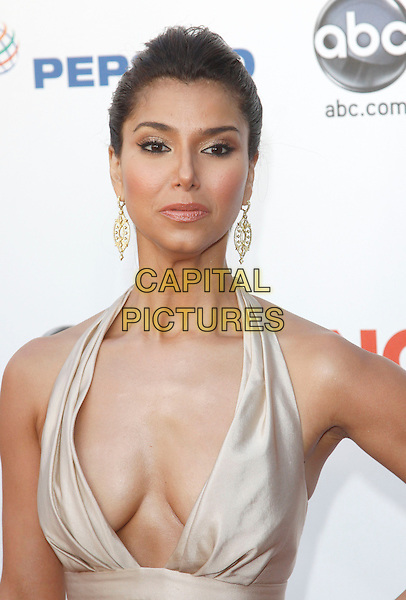 ROSELYN SANCHEZ.The 2009 Alma Awards held at Royce Hall at UCLA in Westwood, California, USA. .September 17th, 2009 .half length dress beige gold plunging neckline cleavage silk satin dangling earrings.CAP/DVS.©Debbie VanStory/Capital Pictures.