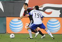 D.C. United forward Hamdi Salihi (9) goes against Montreal Impact defender Zarek Valentin (19) D.C. United defeated Montreal Impact 3-0 at RFK Stadium, Saturday June 30, 2012.