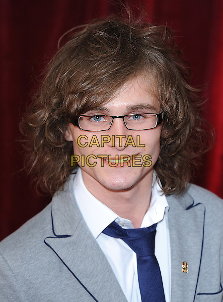 SONNY FLOOD.The British Soap Awards 2010, London Television Centre, London, England..8th May 2010.arrivals headshot portrait black blue white grey gray glasses .CAP/BEL.©Tom Belcher/Capital Pictures.