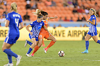 Houston, TX - Wednesday June 28, 2017: Christen Westphal and Carli Lloyd battle for control of the ball  during a regular season National Women's Soccer League (NWSL) match between the Houston Dash and the Boston Breakers at BBVA Compass Stadium.