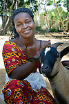 Beatrice Nelson and one of her goats. She was kidnapped and mistreated by rebel soldiers during Liberia's civil wars, but today she's a mother and entrepreneur near Buchanan, Liberia. When she graduated from My Daughter's Place, a program for war-affected girls at Camphor Mission, she received a sewing machine and two goats, and leveraged that capital into a successful small business which today supports her family. My Daughter's Place is supported by United Methodist Women.