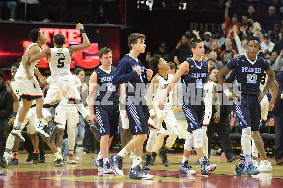 Shawnee players walk off the court as Linden players celebrate winning the New Jersey Group 4 State Championship game Sunday March 12, 2017 at Rutgers University in Piscataway, New Jersey. (Photo by William Thomas Cain)