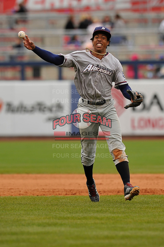 Northwest Arkansas Naturals shortstop Raul Mondesi (27) throws to first base during the game against the Tulsa Drillers at Oneok Field on May 2, 2016 in Tulsa, Oklahoma.  Northwest Arkansas won 9-6.  (Dennis Hubbard/Four Seam Images)