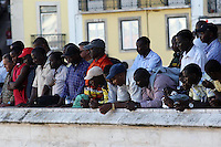 African immigrants look at TV screens in Rossio station during  FIFA Soccer World Cup in Lisbon on 29 June, 2010