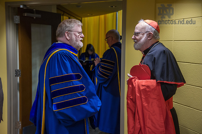May 18, 2014; Vice President for Public Affairs Paul Browne chats with honorary degree recipient Cardinal Seán Patrick O&rsquo;Malley before the 2014 Commencement ceremony.<br /> <br /> Photo by Matt Cashore/University of Notre Dame