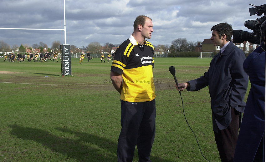 Picture : Greig Cowie.06/02/2002.Wasps Training Session..Twyford Avenue Training Ground. Acton..Lawrence Dallaglio talks too a BBC TV camera crew about his injury problems and when his possible return might be..