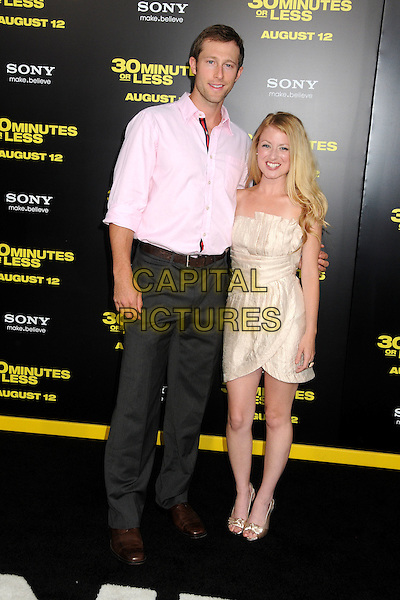 "Casey Bond and Christie Brooke.""30 Minutes or Less"" World Premiere held at Grauman's Chinese Theatre, Hollywood, California, USA..August 8th, 2011.full length white gold silver silk satin strapless dress grey gray trousers pink shirt.CAP/ADM/BP.©Byron Purvis/AdMedia/Capital Pictures."