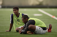 NY Red Bulls midfielder (27) Elie Ikangu talks with defender (2) Marvell Wynne as they stretch after pre-season practice at the Giants Stadium practice bubble, East Rutherford, NJ, on Feb 21, 2007.