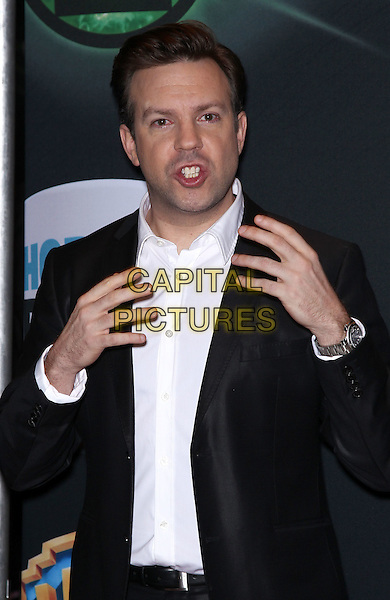 JASON SUDEIKIS.Warner Brothers Pictures presents The Big Picture 2011 at Cinemacon at Caesars Palace Las Vegas, Las Vegas, Nevada, USA..March 31st, 2011.half length black jacket white shirt hands mouth open.CAP/ADM/MJT.© MJT/AdMedia/Capital Pictures.
