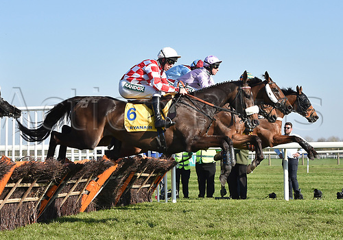 April 8th 2017, Aintree Racecourse, Liverpool, England; Randox Health Grand National Festival Horse racing, Grand National Day; Cole Harden ridden by Gavin Sheehan neck and neck with Three Musketeers ridden by Harry Skelton and Puffin Billy ridden by Leighton Aspell early in the Ryanair Stayers Liverpool Hurdle