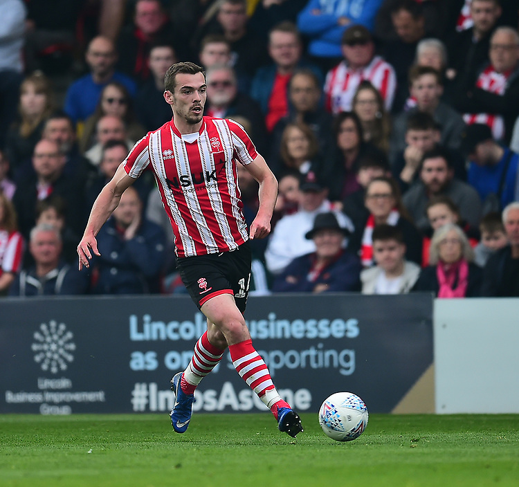 Lincoln City's Harry Toffolo<br /> <br /> Photographer Andrew Vaughan/CameraSport<br /> <br /> The EFL Sky Bet League Two - Lincoln City v Macclesfield Town - Saturday 30th March 2019 - Sincil Bank - Lincoln<br /> <br /> World Copyright © 2019 CameraSport. All rights reserved. 43 Linden Ave. Countesthorpe. Leicester. England. LE8 5PG - Tel: +44 (0) 116 277 4147 - admin@camerasport.com - www.camerasport.com