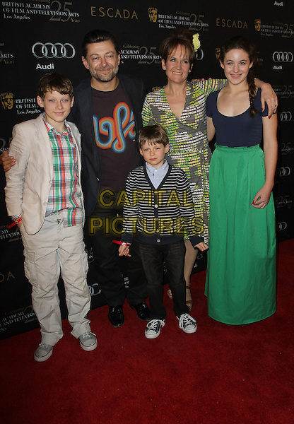 Andy Serkis, Lorraine Ashbourne & family.18th Annual BAFTA Los Angeles Awards Season Tea Party held at the Four Seasons Hotel, Beverly Hills, California, USA..January 14th, 2012.full length husband wife kids children sons daughter green blue dress skirt grey gray suit.CAP/ADM/KB.©Kevan Brooks/AdMedia/Capital Pictures.