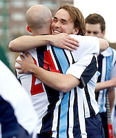 David Eakins (L) and Jaime Gonzalez-Laguillo (R) celebrate Hampstead's victory during the England Hockey League Mens Semi-Final Cup game between Hampstead & Westminster and Sevenoaks at the Paddington Recreation Ground, Maida Vale on Sun March 21, 2010