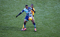Myles Weston of Wycombe Wanderers holds off Abdoulaye Meite of Newport County during the Sky Bet League 2 match between Wycombe Wanderers and Newport County at Adams Park, High Wycombe, England on 2 January 2017. Photo by Andy Rowland.