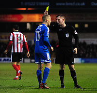 Notts County's Terry Hawkridge is shown a yellow card by referee Ross Joyce<br /> <br /> Photographer Chris Vaughan/CameraSport<br /> <br /> The EFL Sky Bet League Two - Lincoln City v Notts County - Saturday 13th January 2018 - Sincil Bank - Lincoln<br /> <br /> World Copyright &copy; 2018 CameraSport. All rights reserved. 43 Linden Ave. Countesthorpe. Leicester. England. LE8 5PG - Tel: +44 (0) 116 277 4147 - admin@camerasport.com - www.camerasport.com