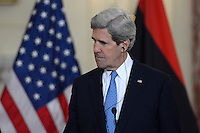 March 13, 2013  (Washington, DC)  Secretary of State John Kerry listens to Libyan Prime Minister Ali Zeidan speak before a bilateral meeting at the Department of State in Washington, D.C.  (Photo by Don Baxter/Media Images International)