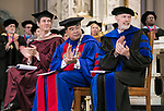 Jeffrey Bethke, executive vice president, A. Gabriel Esteban, Ph.D., president and Marten denBoer, provost, (left to right) applaud the <br /> DePaul University faculty during the awards ceremony Thursday, Aug. 31, 2017, at the annual Academic Convocation. (DePaul University/Jamie Moncrief)