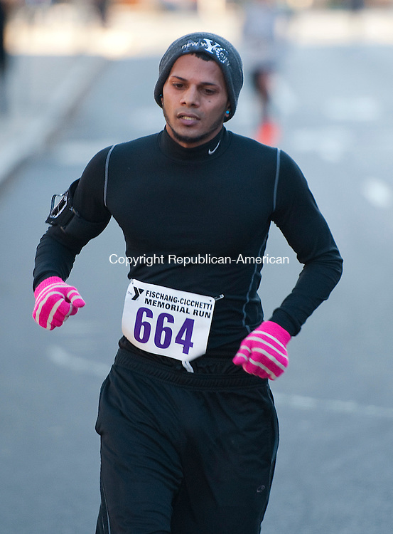 WATERBURY 112413JS06- Andrew Balgobin of Waterbury, with a time of  21:49, was the top make finisher in the 5K during the annual Fischang-Cicchetti Memorial Run Sunday in Waterbury.<br /> Jim Shannon Republican-American