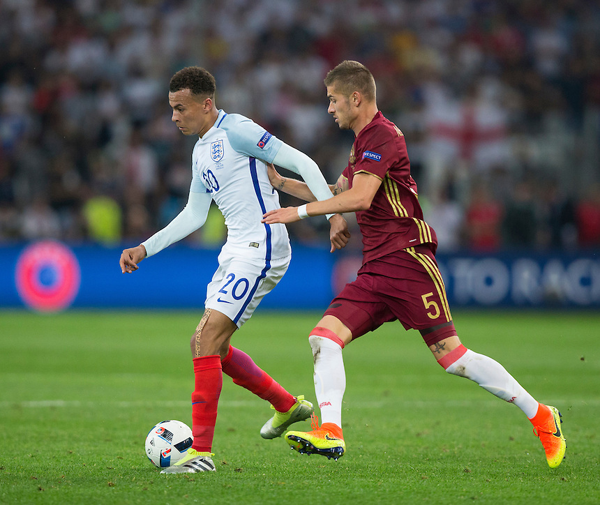 England's Dele Alli holds off the challenge from Russia's Roman Neustadter<br /> <br /> Photographer Craig Mercer/CameraSport<br /> <br /> International Football - 2016 UEFA European Championship - Group B - England v Russia - Saturday 11th June 2016 - Stade Velodrome, Marseille - France <br /> <br /> World Copyright &copy; 2016 CameraSport. All rights reserved. 43 Linden Ave. Countesthorpe. Leicester. England. LE8 5PG - Tel: +44 (0) 116 277 4147 - admin@camerasport.com - www.camerasport.com