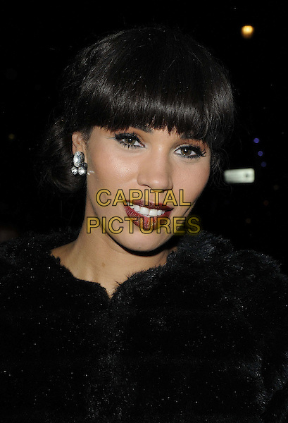Javine Hylton.The 'Spamalot' press night, Playhouse Theatre, Northumberland Avenue, London, England..November 20th, 2012.headshot portrait dark red lipstick black fur .CAP/CAN.©Can Nguyen/Capital Pictures.